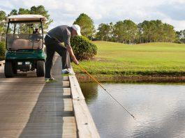 retreiving golf ball from water hazard Getty Images/iStockphoto