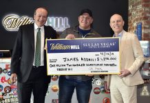 William Hill US Presents Bettor With $1.19M Check At William Hill Sports Book At SLS Casino After Tiger Woods' Masters Victory Getty Images for William Hill US
