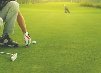 Marking golf ball position on the green Getty Images/iStockphoto