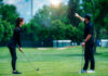 Playing golf. Young woman playing golf with golf instructor Stevica Mrdja